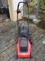 Sweet little German electric mini-lawnmower in Spangdahlem, Germany