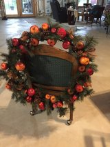 Wreath with berries fruit and pine cones in Oswego, Illinois