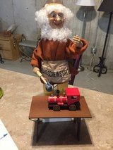 Electric moving elf toy maker in Naperville, Illinois