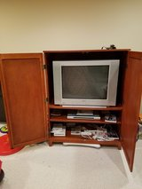 TV and TV Stand in Westmont, Illinois