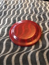 Translucent red frisbee in Chicago, Illinois