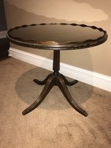 Antique round wood side table in Naperville, Illinois