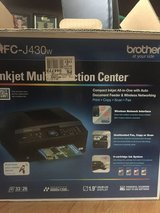 Brother inkjet multi function center with some ink cartridges in Chicago, Illinois