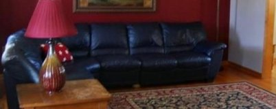 Natuzzi leather sectional couch in Watertown, New York
