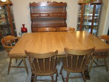 Dining table with 6 chairs and hutch good condition.Solid wood. Table expands W/3 leaves. Price ... in Leesville, Louisiana
