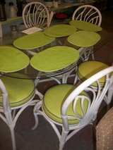 Glass top table w/ 6 chairs and matching mats. in Cherry Point, North Carolina