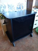 solid black tv / computer cabinet with smoked glass doors in 29 Palms, California