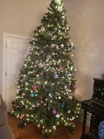10 feet artificial christmas tree with stand and partial light in Aurora, Illinois