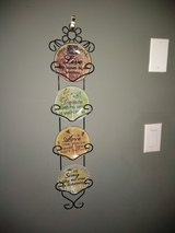 Hanging plate wall decor in Fort Campbell, Kentucky