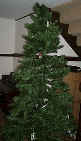 Beautiful 7'  Prelighted Christmas tree with ornaments.  Used one season. Excellent condition! in Bellevue, Nebraska