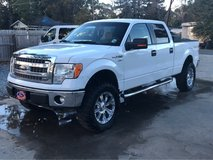 """2014 F150 XLT 4x4 long bed with-35"""" tires on 20 """" rims in Fort Polk, Louisiana"""