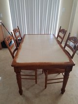 wood table with glass tile and 4 wood chairs in Lackland AFB, Texas