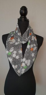 Kimono scarf speckled black with maple leaves in Okinawa, Japan