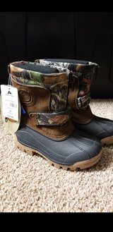 New boys camo winter boots size 10 in Plainfield, Illinois