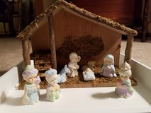 Porcelain nativity set with wooden manger in Plainfield, Illinois