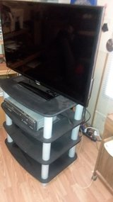 "36"" Hisense flat screen  TV with TV stand in Alamogordo, New Mexico"
