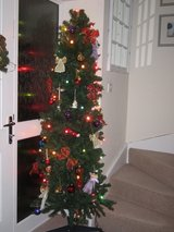 Tall, slim artificial Christmas tree in Lakenheath, UK