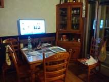 Table, 4 chairs and corner china cabinet in Bartlett, Illinois
