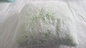 Modern mint fuzzy pillow in Fort Carson, Colorado