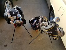Two sets of golf clubs with bags in Fort Polk, Louisiana