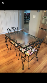 Heavy black wrought iron table/glass top 2 chairs in Camp Lejeune, North Carolina