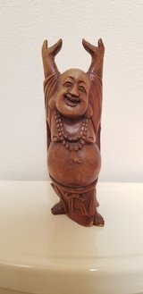 Smiling Wooden Buddha in Fort Carson, Colorado
