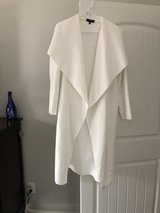 Off white coat in Pleasant View, Tennessee