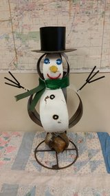 Snowman with rock base in Naperville, Illinois