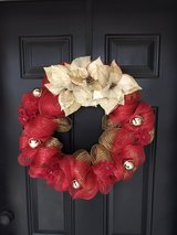 Red and gold wreath with bells in Cochran, Georgia