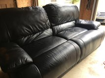 Black leather couch and chair set in Perry, Georgia