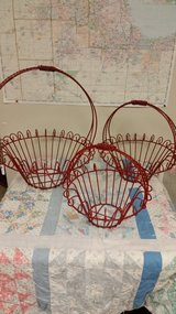 Round red iron baskets in Plainfield, Illinois