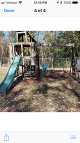Wooden swing set with club house and slide in Conroe, Texas