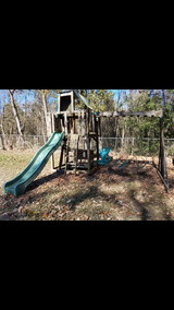 Heavy Wooden swing set with club house and slide in The Woodlands, Texas
