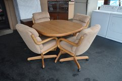 Oak Dinette with 4 Chairs on rollers in Fort Lewis, Washington