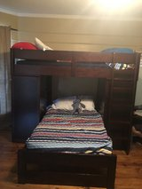 Bunk bed with desk, cabinet, and shelves in Kingwood, Texas