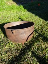Rusty cast iron pot in Tomball, Texas