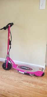 pink Razor E100 electric scooter with charger in Perry, Georgia