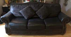 Brown sofa and chair made by Ashley furniture in Kingwood, Texas