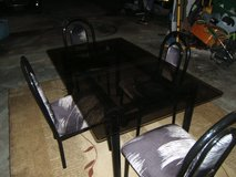 Glass table with 4 chairs in Camp Lejeune, North Carolina