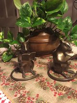 A pair of metal reading mice figurines in Vacaville, California