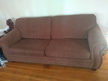 Couch with bed in plastic in Clarksville, Tennessee