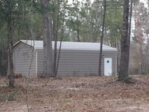 Approx 2.3 acres with shop and power backing up to river in Kingwood, Texas