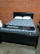 Beat this deal!new queen black sleigh bed with new pillowtop mattress in Wilmington, North Carolina