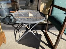 Folding metal side table in Aurora, Illinois
