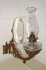 Antique wall mount swivel holder with mirror reflector for oil lamps in Chicago, Illinois