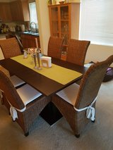 Table with six wicker chairs in Fort Lewis, Washington