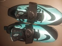SIZE 4 BLUE AND BLACK NIKE SHOES. in Beaufort, South Carolina