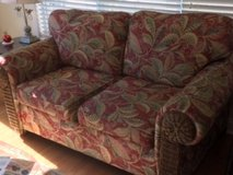 Two Seater Sofa Upholstered with Wicker inset on the arms in Wilmington, North Carolina
