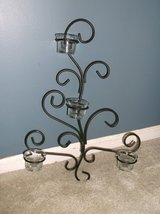 Wrought iron black wall scounce for candles in Naperville, Illinois