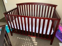 brown baby crib in Cleveland, Texas
